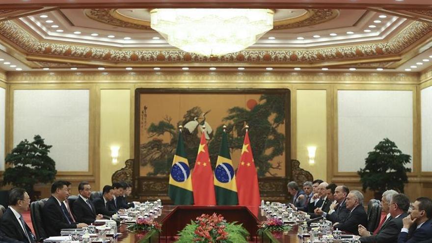China tiende la mano a los planes económicos de Brasil en la visita de Temer