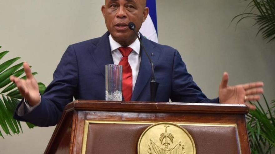 Martelly y la oposición haitiana se reúnen por primera vez en medio de la crisis