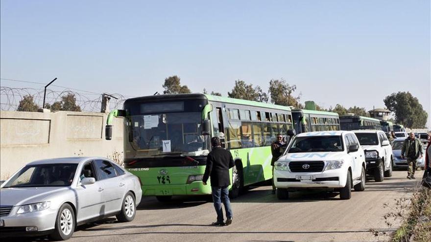Llegan al norte de Siria la mayoría de combatientes y civiles evacuados de Homs