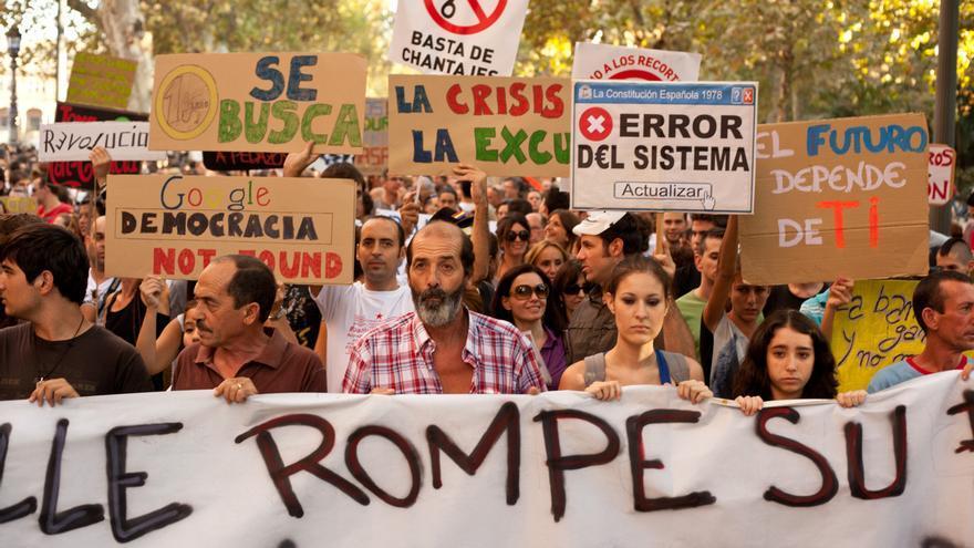 Manifestación del 15O a su paso por la Plaza de España