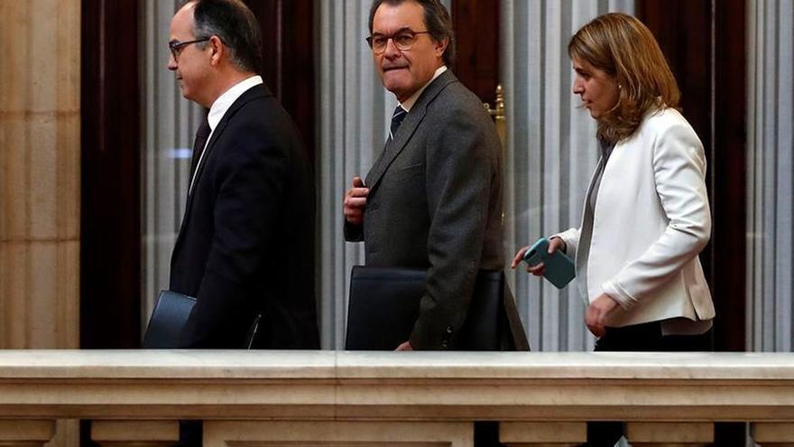 Los miembros del PDECat Jordi Turull, Artur Mas y Marta Pascal, en el Parlament