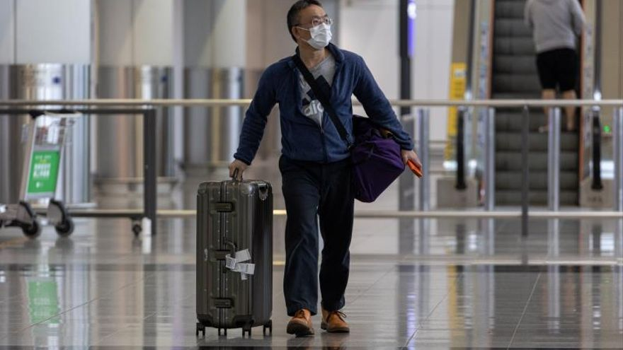 A traveller wears a mask in the arrival hall of the Hong Kong International Airport in Hong Kong, China, 22 January 2020.