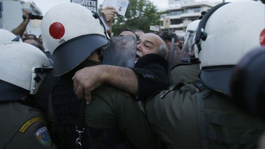 Riot police stormed the main premises of Greece's public broadcaster on Thursday in Athens, ending an almost five-month occupation by workers opposing the shutdown of the broadcaster, but prompting the country's opposition party to call for a no-confidence vote in the government. THANASSIS STAVRAKIS/ASSOCIATED PRESS