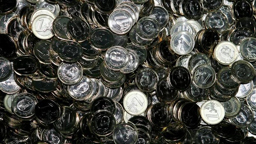 El euro sube a 1,1651 dólares