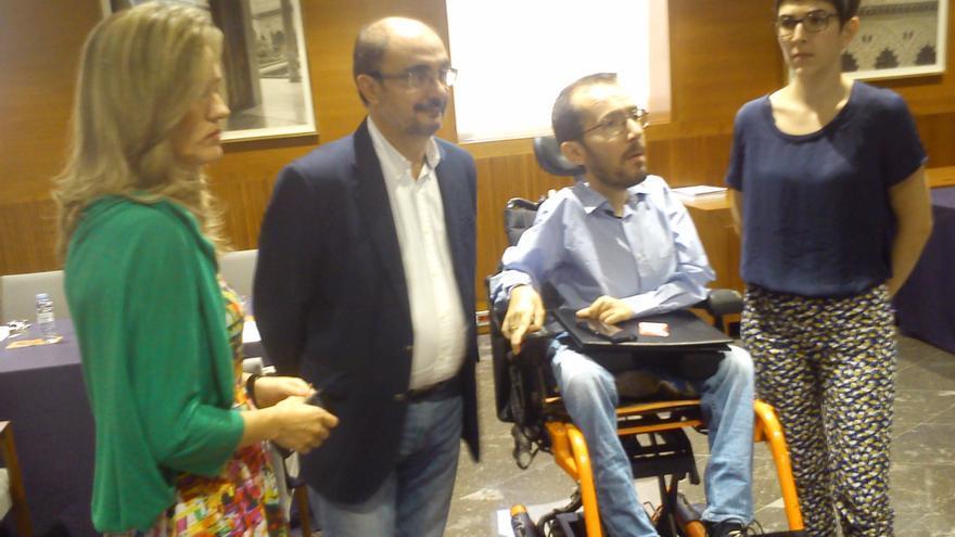 De izquierda a derecha, Pilar Alegría y Javier Lambán (PSOE) con Pablo Echenique y Violeta Barba (Podemos)