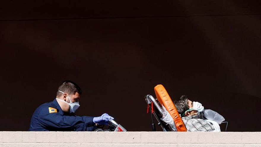 Paramedics bring a patient into the emergency room entrance of the Wyckoff Heights Medical Center in Brooklyn, New York, USA, 01 April 2020.
