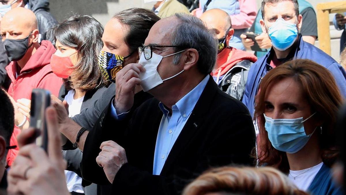 Los candidatos a la Comunidad de Madrid de Unidas Podemos, Pablo Iglesias; PSOE, Ángel Gabilondo, y Más Madrid, Mónica García, participan en la manifestación del Primero de Mayo, convocada este sábado en Madrid.