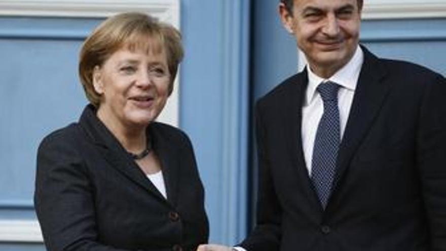 José Luis Zapatero Y Angela Merkel