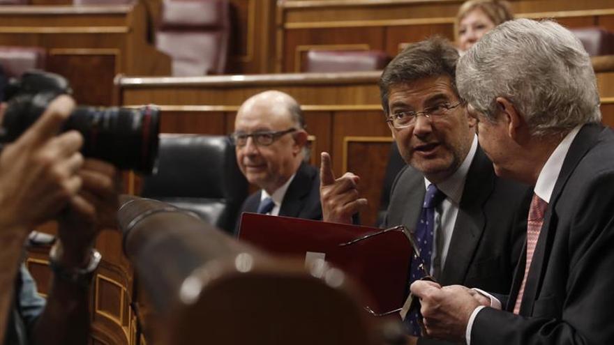 Dastis: España hace lo que está en su mano con refugiados, según normas de UE