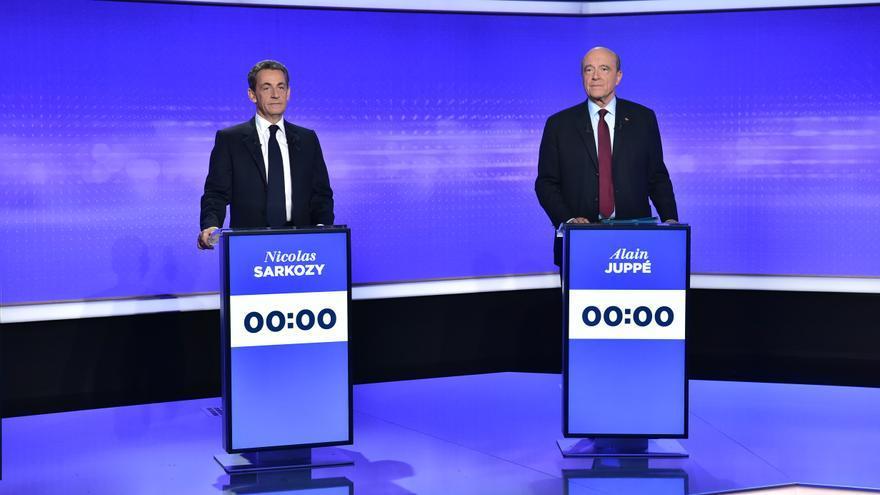 Los dos principales aspirantes a la candidatura de Los Republicanos a la presidencia de Francia, Nicolas Sarkozy y Alain Juppé