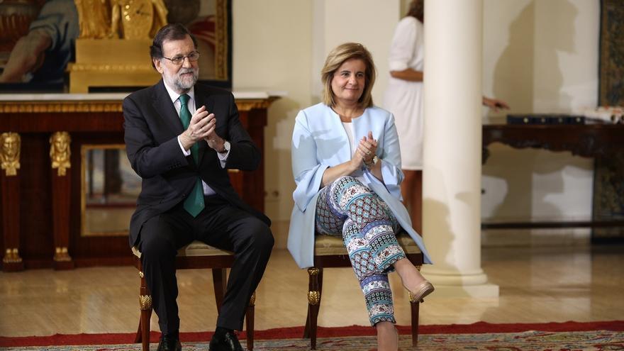 Mariano Rajoy y Fátima Báñez, dos de las caras más visibles de la reforma de las pensiones del PP en 2013.