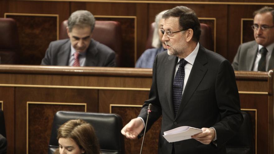 """Rajoy: La """"voluntad"""" del Gobierno es que el impuesto a los depósitos bancarios entre en vigor en 2014"""