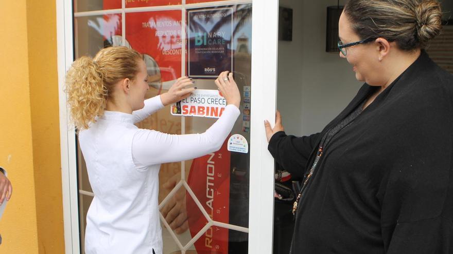 Comerciantes de El Paso promocionando el concierto de Sabina.