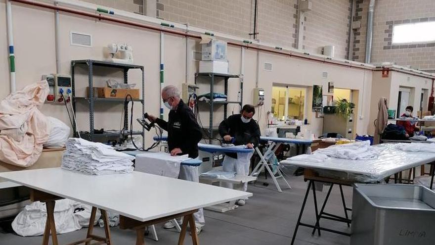 Trabajo en una lavandería dentro del programa Ejea Sociedad Cooperativa de Iniciativa Social