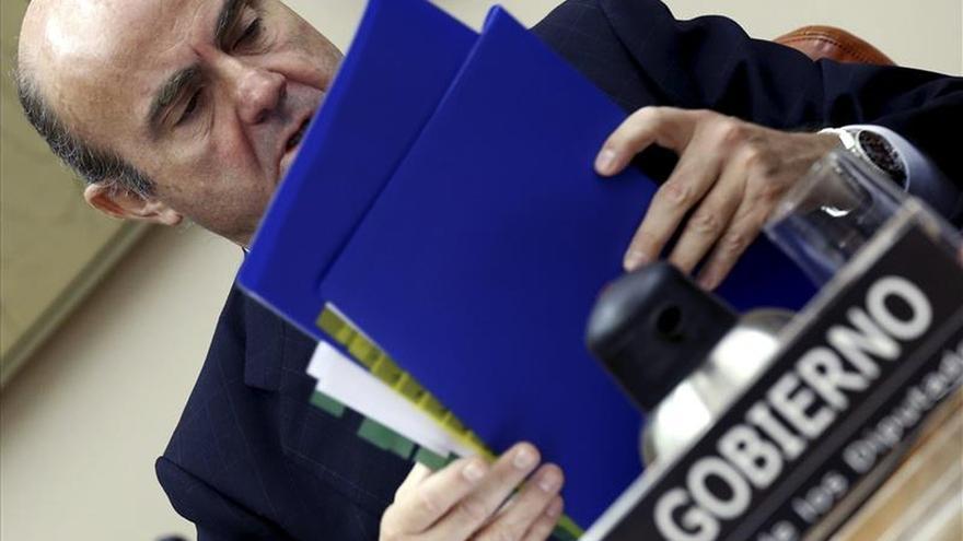 """De Guindos dice que el Estado recuperará la """"gran mayoría"""" de las ayudas a la banca"""