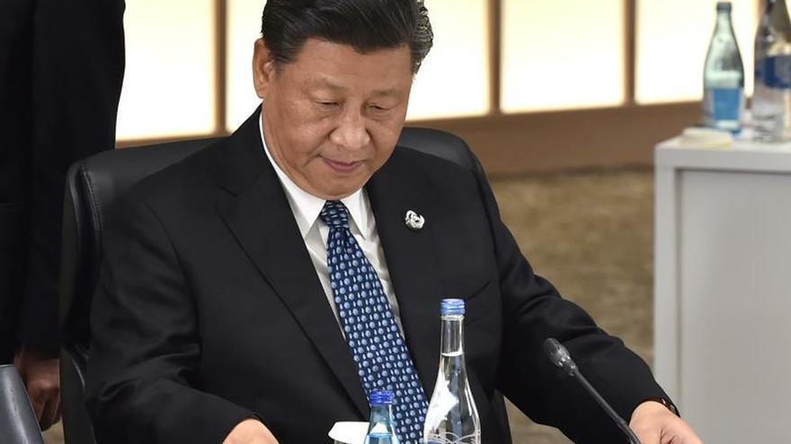 Resultado de imagen para Activista chino muere bajo arresto, quien pidió la dimisión de Xi Jinping