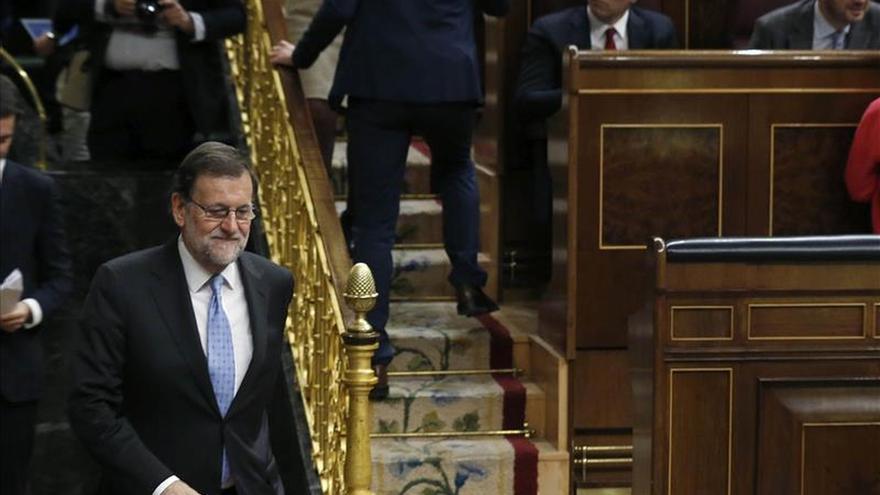 Rajoy reafirma a Merkel compromiso de España como firme aliado antiterrorista