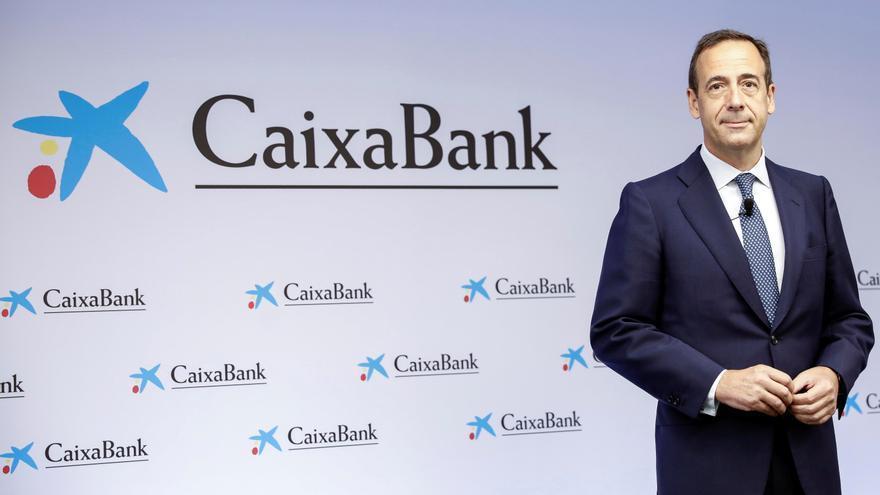CaixaBank gana 4.181 millones por la fusión y repartirá el 50 % en dividendos