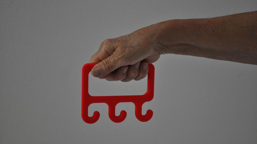 Triple gancho hecho por la impresora 3D Replicator