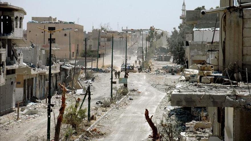 Vista general de los daños en un sector el 5 de junio de 2013, en la localidad estratégica de Al Quseir, Siria.