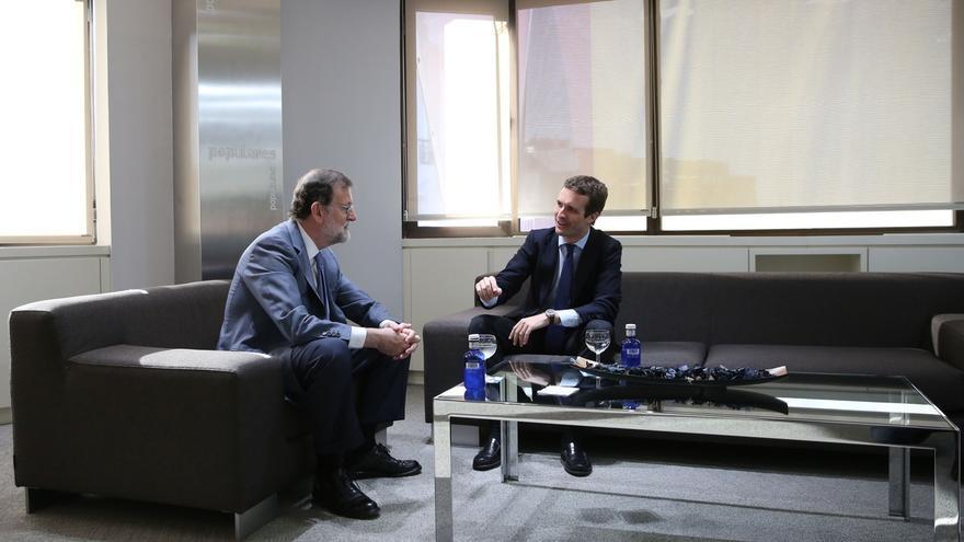 Casado y Rajoy mantienen la primera reunión en Génova tras el Congreso del PP