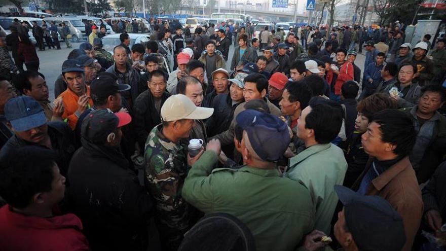 China propone a los desempleados de las ciudades que se muden a zonas rurales