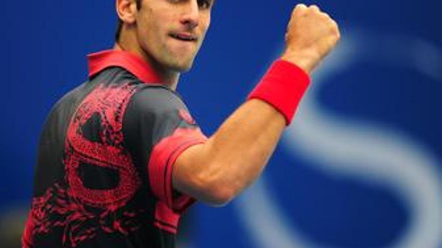 Djokovic celebra su triunfo sobre Isner