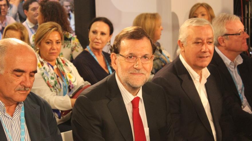 Rajoy en la Intermunicipal del PP, entre Alberto Garre y Javier Arenas / PSS