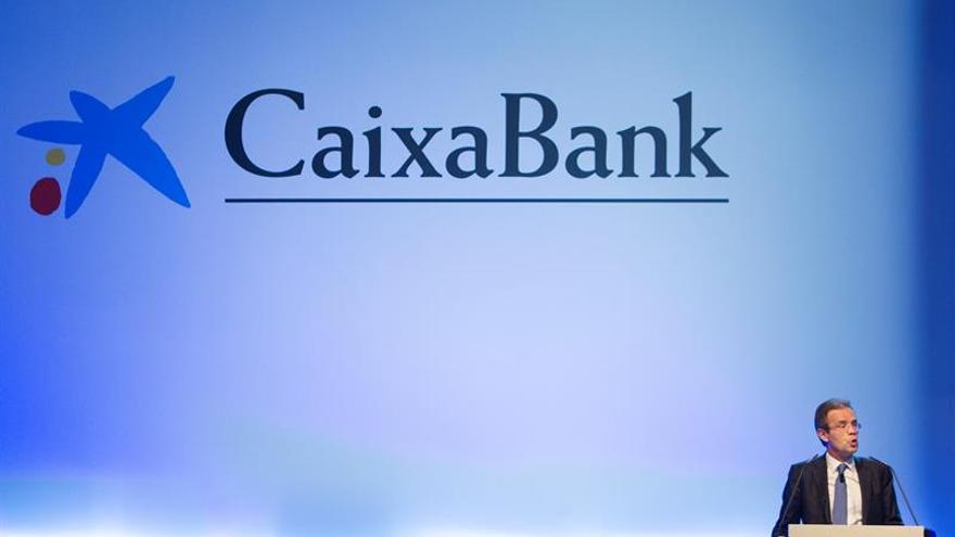 CaixaBank gana 839 millones, 31,6% más, por BPI y mejora ingresos bancarios
