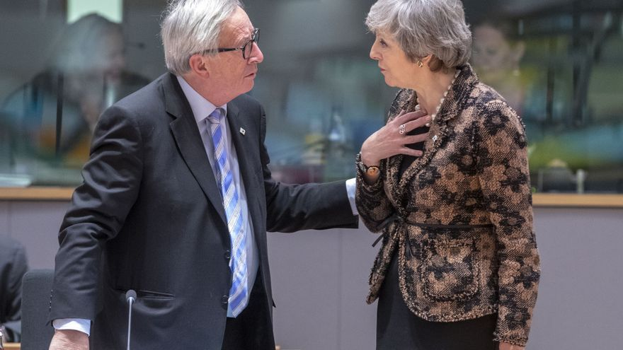 Jean-Claude Juncker y Theresa May,