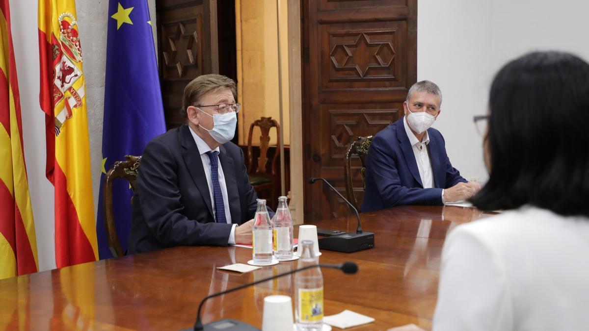 El president de la Generalitat, Ximo Puig, junto al conseller de Economia Sostenible, Rafael Climent.