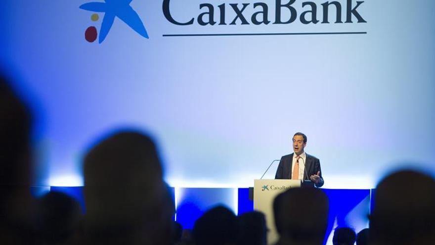 CaixaBank reivindica su liderazgo en el mercado ibérico tras la compra de BPI