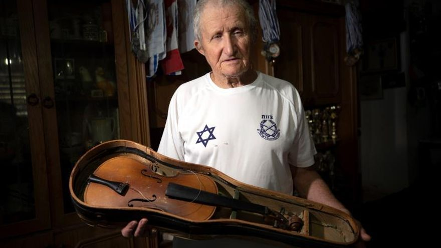 Hanoch Shacher, a Holocaust survivor born in Czech in 1935, survivor of the Theresienstadt concentration camp in what is now the Czech Republic and moved to Israel in 1949, holds his violin that he carried form Theresienstadt concentration camp, in northern city of Tzfat, Israel, 11 March 2019 (Issued 21 January 2020).