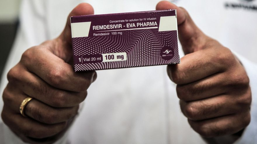 An employee of Egyptian pharmaceutical company Eva Pharma holds a pack containing vials of Remdesivir, a broad-spectrum antiviral medication approved as a specific treatment for COVID-19, at the company's factory, which started producing the drug this week with a production capacity of up to 1.5 million doses per month. Photo: Fadel Dawood/dpa
