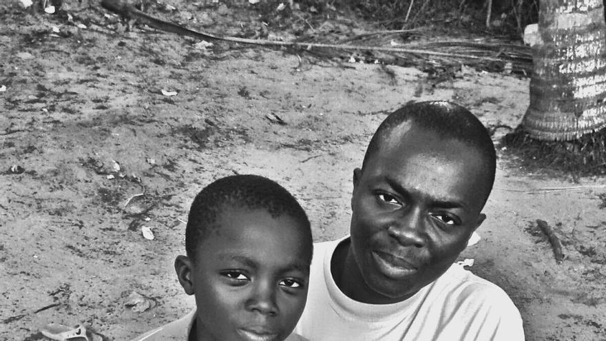 Adou y su padre, Ali Ouattara