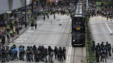 Protesters standoff with riot police during a rally against the implementation of a new national security law in Causeway Bay, Hong Kong, China, 24 May 2020.