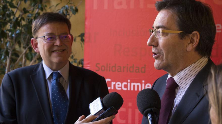 El presidente de la Generalitat, Ximo Puig, y el el presidente de la Confederación de Cooperativas de la Comunitat Valenciana, Emili Villaescusa.
