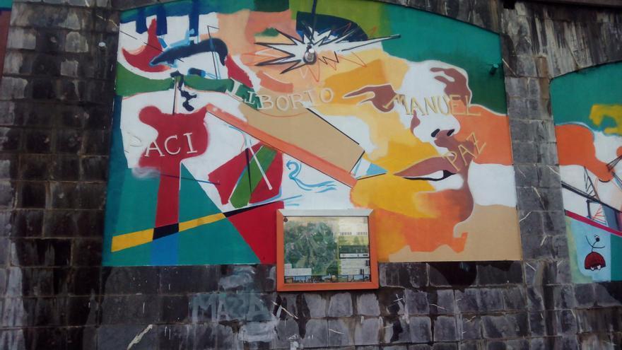 Uno de los murales sobre el atentado del bar Aldana pintados por el artista Carlos Morales Baudillo