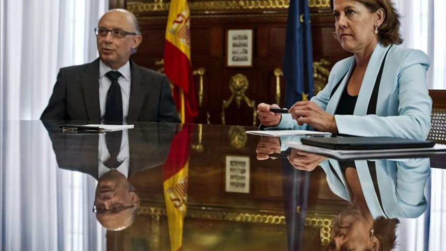 Montoro y Barcina, durante una de las reuniones para renovar el Convenio / Foto: Efe.