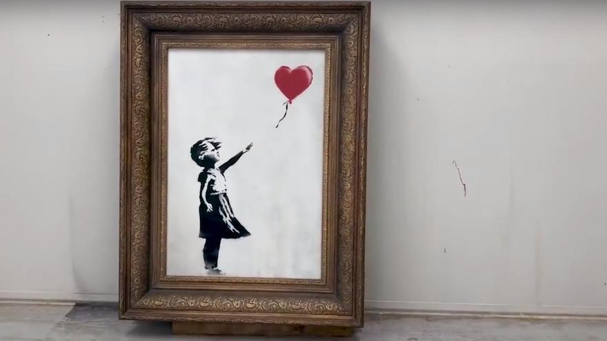 Girl with balloon antes de venderse en Sotheby's según el vídeo Shredding the Girl and Balloon - The Director's Cut