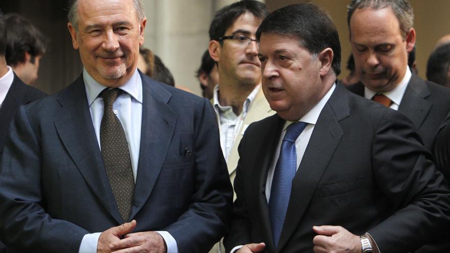 El expresidente de Bankia, Rodrigo Rato, y el expresidente de Bancaja, José Luis Olivas