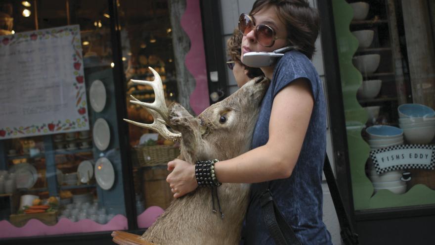 C:\fakepath\MCGILL2_nyc-girl-carrying-deer-head.jpg