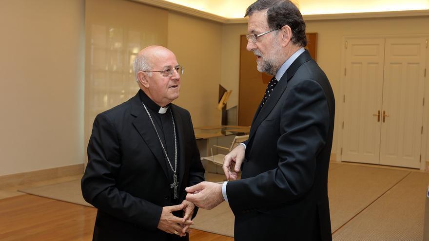 Ricardo Blázquez, presidente de la Conferencia Episcopal, junto al presidente del Gobierno, Mariano Rajoy