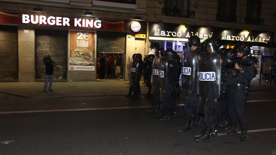 Policías antidisturbios en formación en una calle de Madrid el pasado fin de semana.