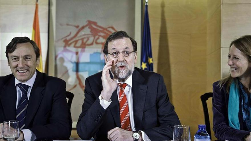 Rafael Hernando junto a Mariano Rajoy
