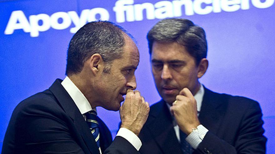 Francisco Camps y su vicepresidente Vicente Rambla, en un acto de apoyo financiero público para empresas.