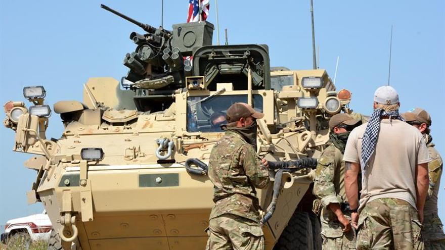 Resultado de imagen de Fuerzas estadounidenses de la coalición internacional y milicias kurdas