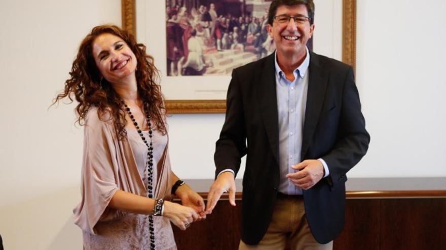La ex consejera y ministra de Hacienda en funciones, María Jesús Montero, junto al líder andaluz de Cs y actual vicepresidente de la Junta, Juan Marín.