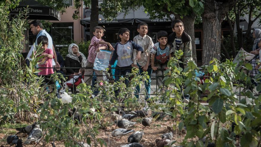 Refugiados en la plaza de La Victoria, en Atenas
