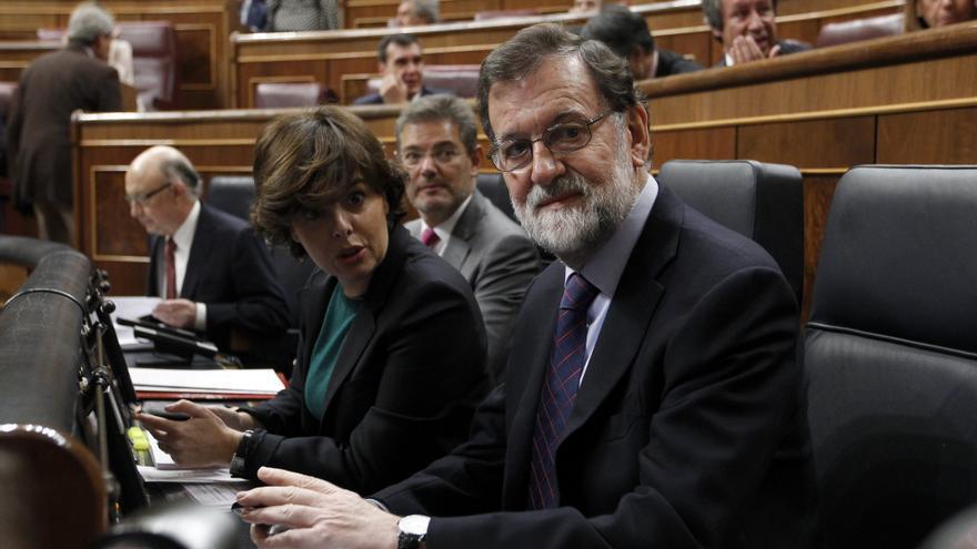Mariano Rajoy, Soraya Sáenz de Santamaría y Rafael Catalá, durante la sesión de control al Gobierno